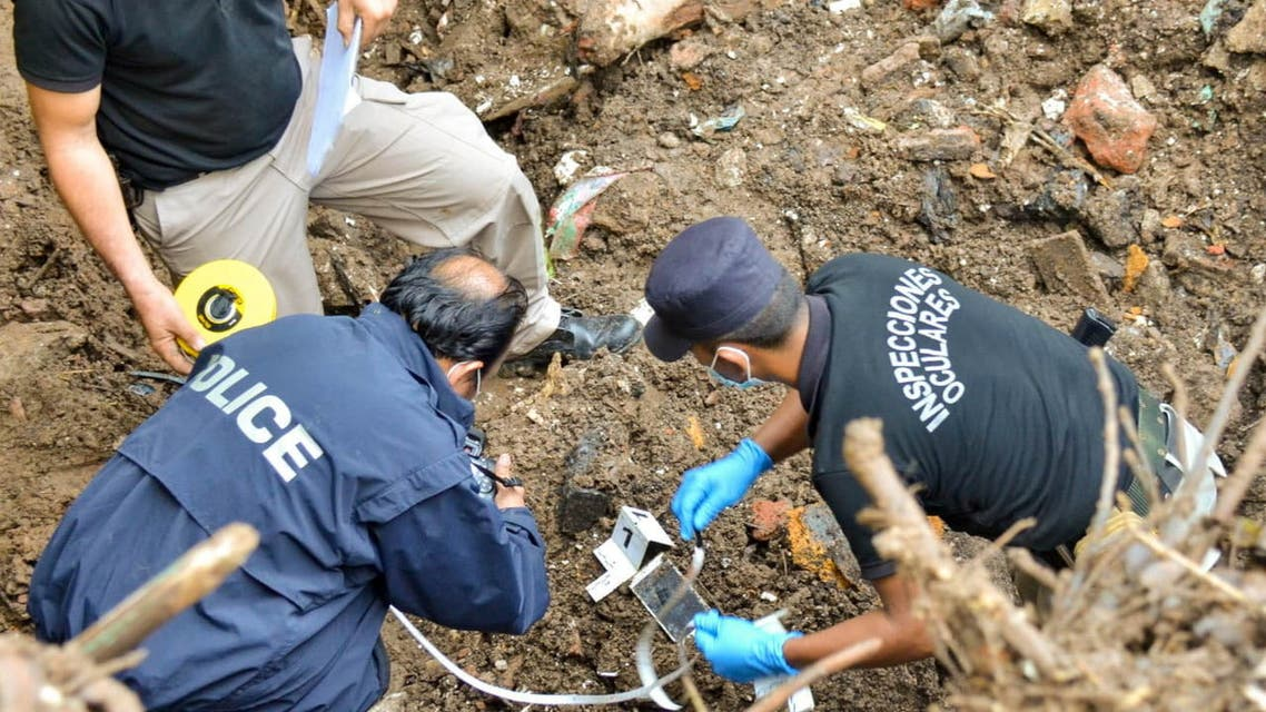 Police investigators work in the crime scene to recover the body of Flor Maria Garcia Valle, who disappeared on March 2021, in Cojutepeque, El Salvador June 29, 2021. (Reuters)
