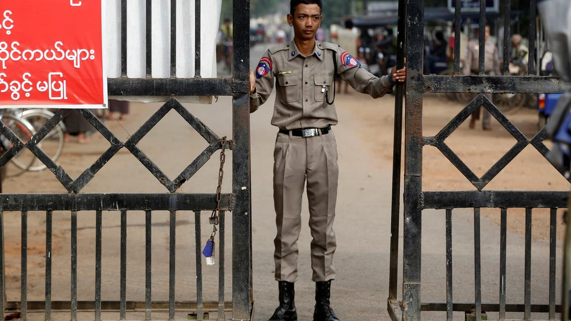 A prison staff stands guard at Insein prison in Yangon, Myanmar, January 3, 2019. (Reuters)