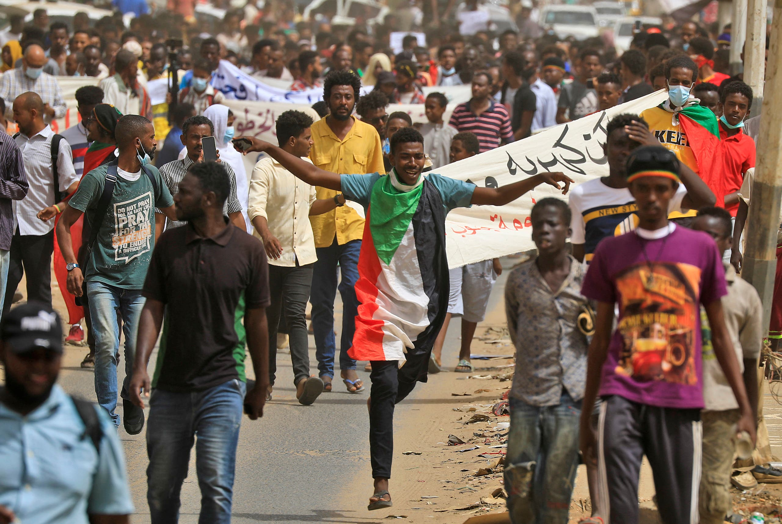 Sudanese protesters take part in a demonstration in the capital Khartoum on June 30, 2021, urging the government to step down over delayed justice and recent harsh economic reforms. (AFP)