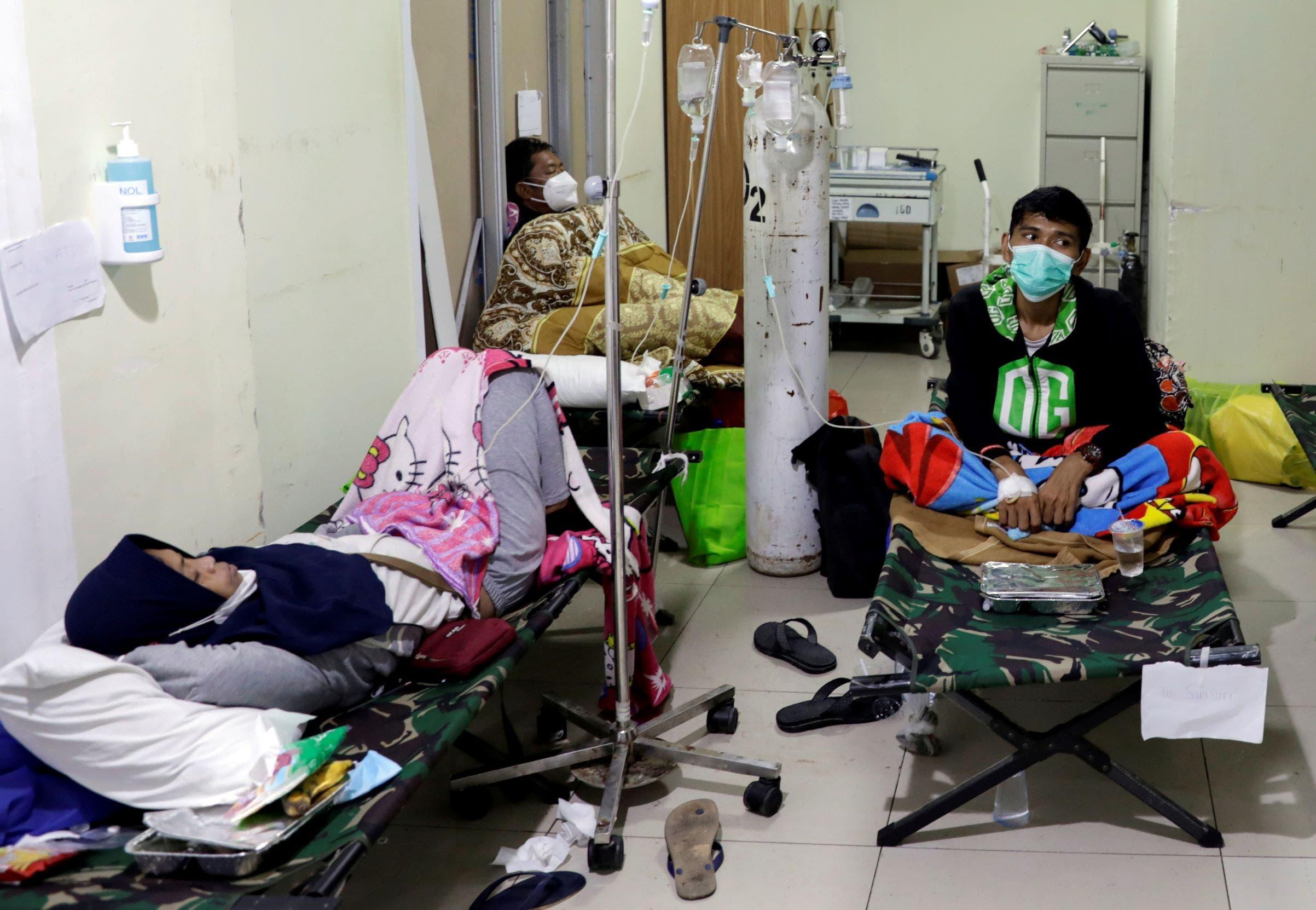 أندونيسيون مصابون بكورونا