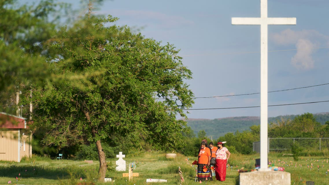 A group of women walk in a field where human remains were discovered in unmarked graves at the site of the former Marieval Indian Residential School on the Cowessess First Nation in Saskatchewan on June 26, 2021. More than 750 unmarked graves have been found near a former Catholic boarding school for indigenous children in western Canada, a tribal leader said. (File photo: AFP)