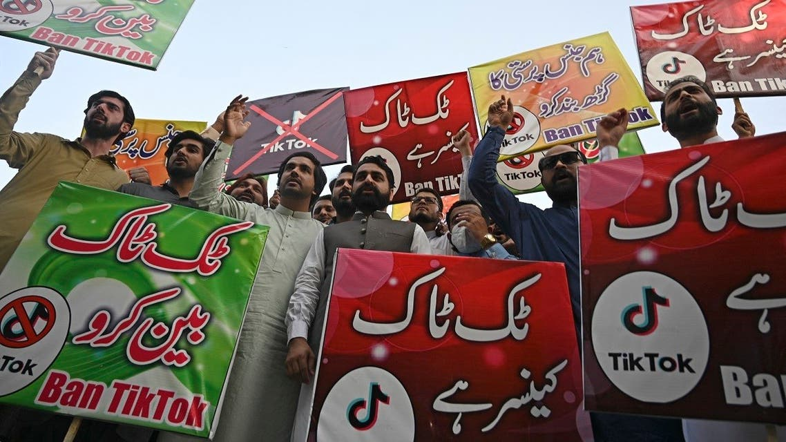Activists carry banners and placards as they take part in a demonstration demanding the ban of a social media application 'TikTok' in Islamabad on June 26, 2021. (Farooq Naeem/AFP)