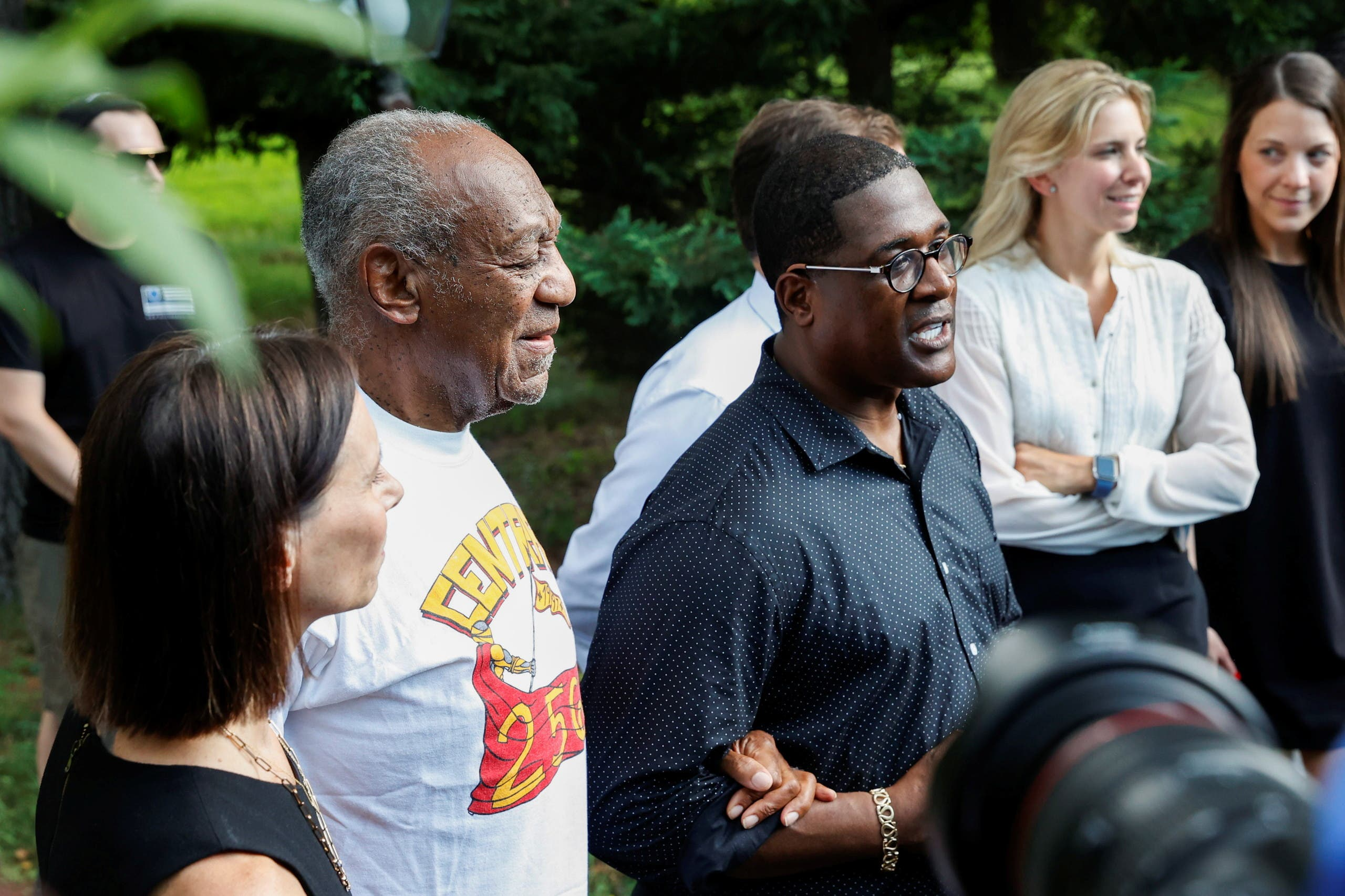 Bill Cosby stands next to his spokesperson Andrew Wyatt, and lawyer Jennifer Bonjean outside his house after Pennsylvania's highest court overturned his sexual assault conviction and ordered him released from prison immediately, in Elkins Park. (Reuters)
