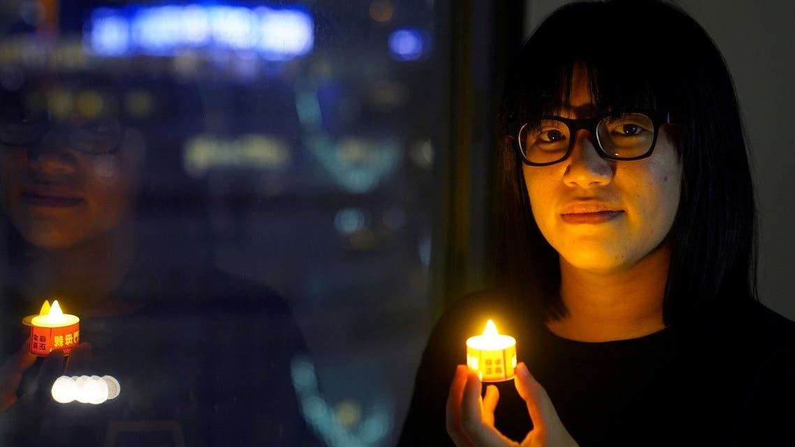 Vice-chairwoman of Hong Kong Alliance in Support of Patriotic Democratic Movements of China, Chow Hang-tung, poses with a candle ahead of the 32nd anniversary of the crackdown on pro-democracy demonstrators at Beijing's Tiananmen Square in 1989, in Hong Kong, China, on June 3, 2021. (Reuters)