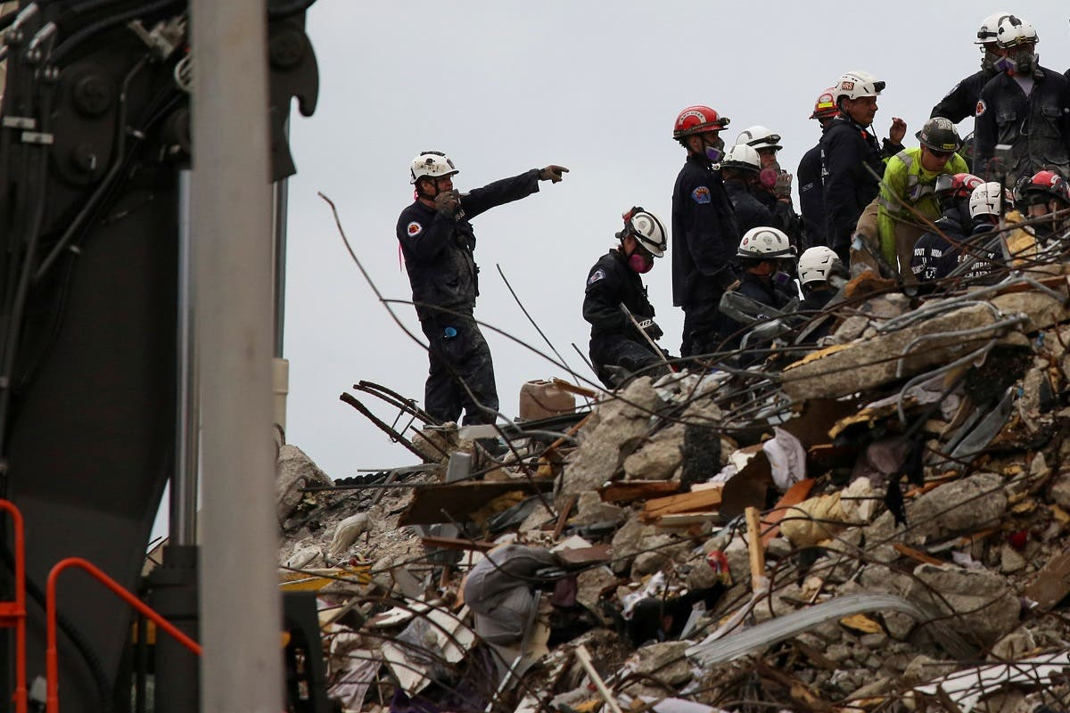 Rescue personnel continue the search and rescue operation for survivors at the site of a partially collapsed residential building in Surfside, near Miami Beach, Florida, U.S. June 30, 2021. (Reuters)