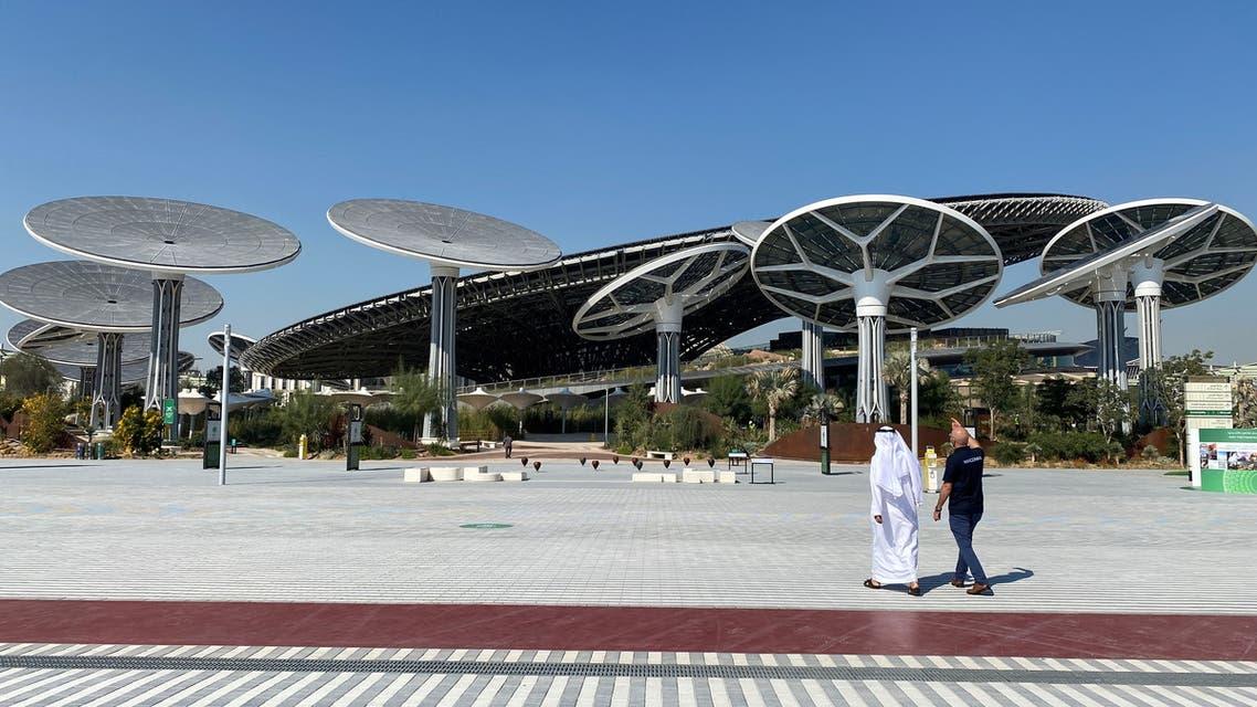 People walk at the site of Dubai Expo 2020 in Dubai. (Reuters)