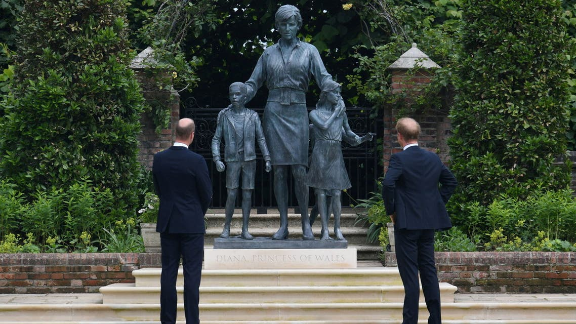 Britain's Prince William, The Duke of Cambridge, and Prince Harry, Duke of Sussex, react during the unveiling of a statue they commissioned of their mother Diana, Princess of Wales, in the Sunken Garden at Kensington Palace, London, Britain July 1, 2021. Dominic Lipinski/Pool via REUTERS