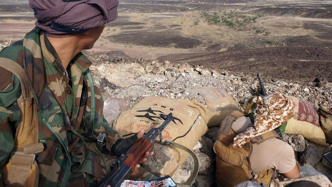 Fighters loyal to Yemen's Saudi-backed government mans a position near the frontline facing Iran-backed Huthi rebels in the country's northeastern province of Marib, on May 13, 2021.