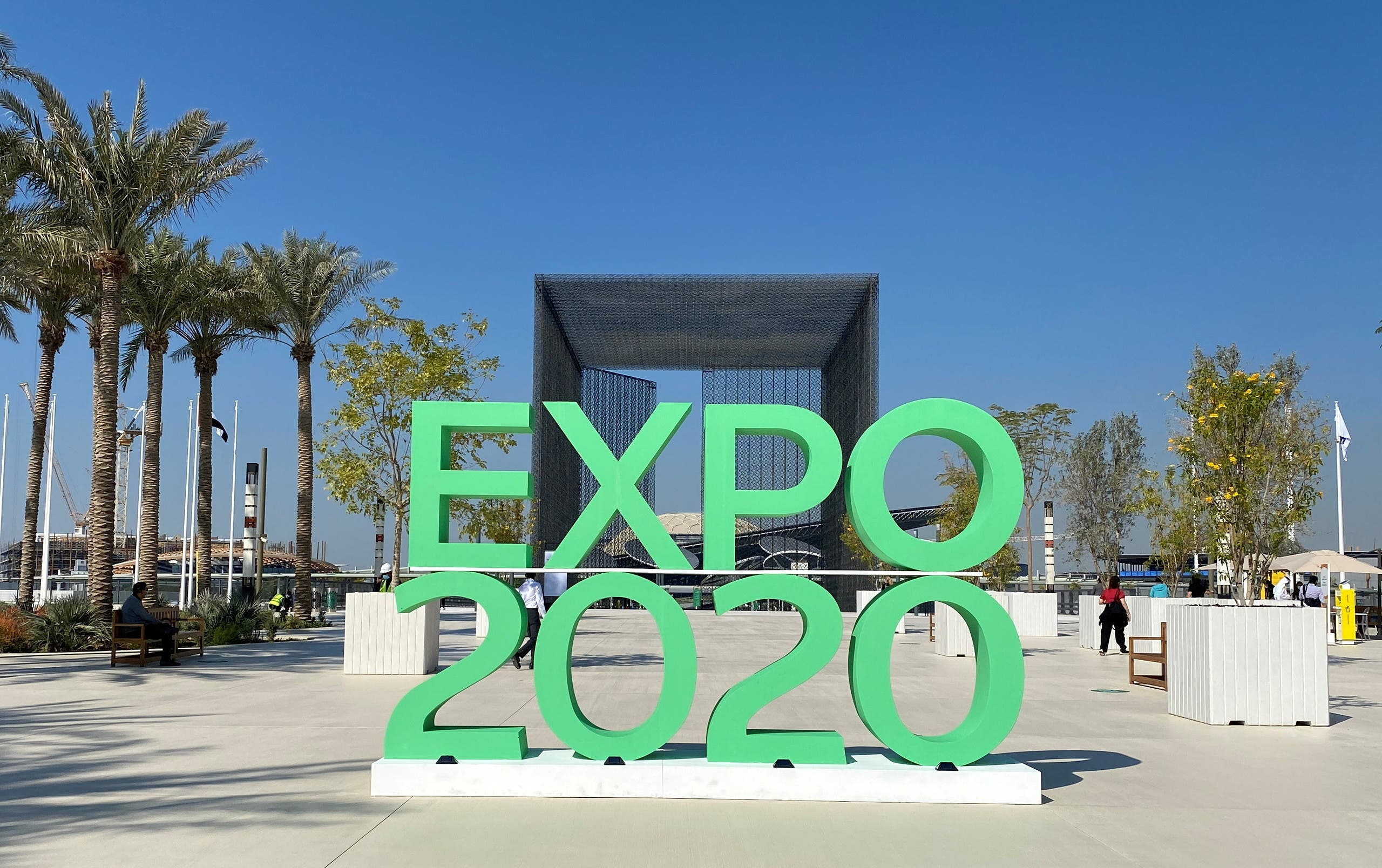 The sign of Dubai Expo 2020 is seen at the entrance of the site in Dubai. (Reuters)