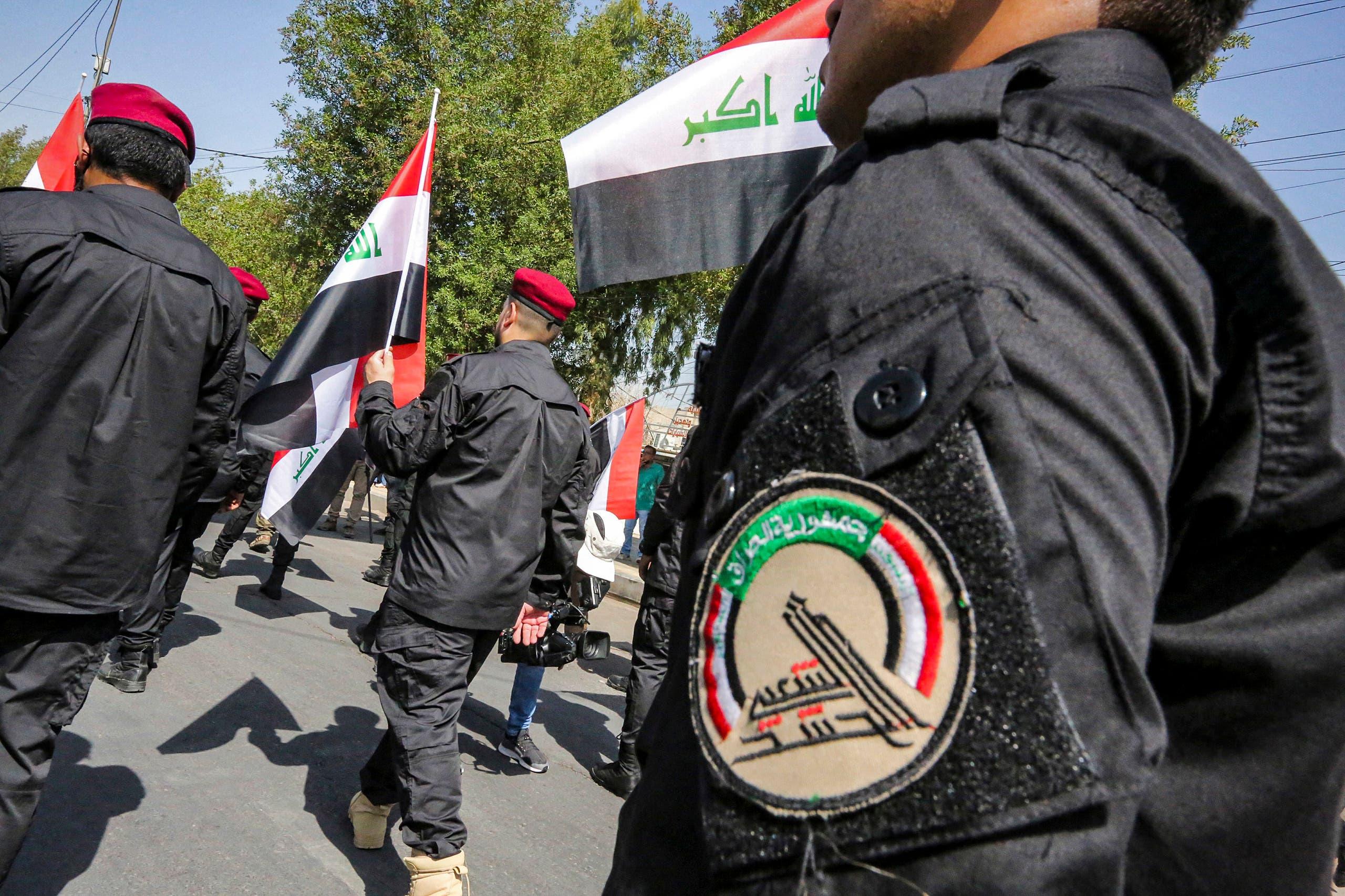 استعراض للحشد الشعبي في بغداد في يونيو الماضي