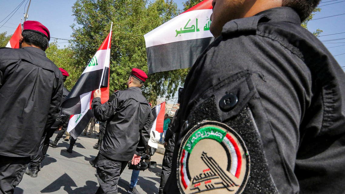 Members of Iraq's Hashed al-Shaabi (Popular Mobilisation) paramilitary forces march in a symbolic funerary parade in the capital Baghdad on June 29, 2021, in remembrance of those killed in a US raid against one of the Hashed's brigades.