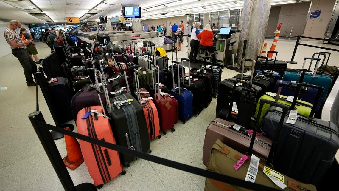 Baggage stacks up from delayed travellers in the baggage claim area in Denver International Airport Wednesday, June 16, 2021, in Denver, US. (AP)