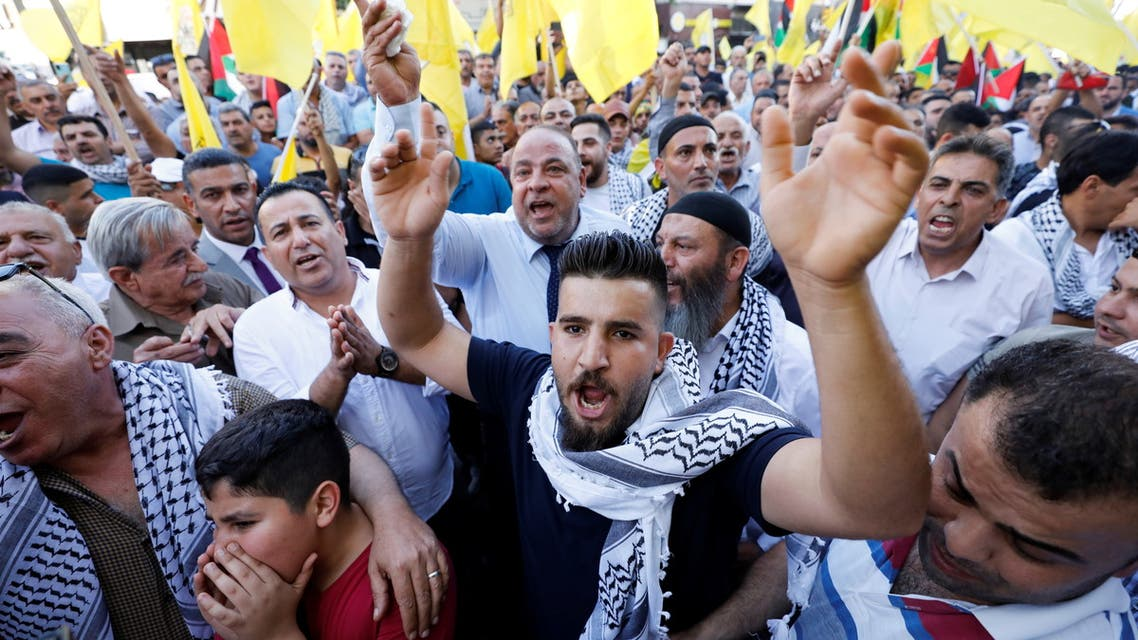 Palestinian demonstrators attend a protest in support of Palestinian President Mahmoud Abbas, in Hebron in the Israeli-occupied West Bank, July 3, 2021. (Reuters)
