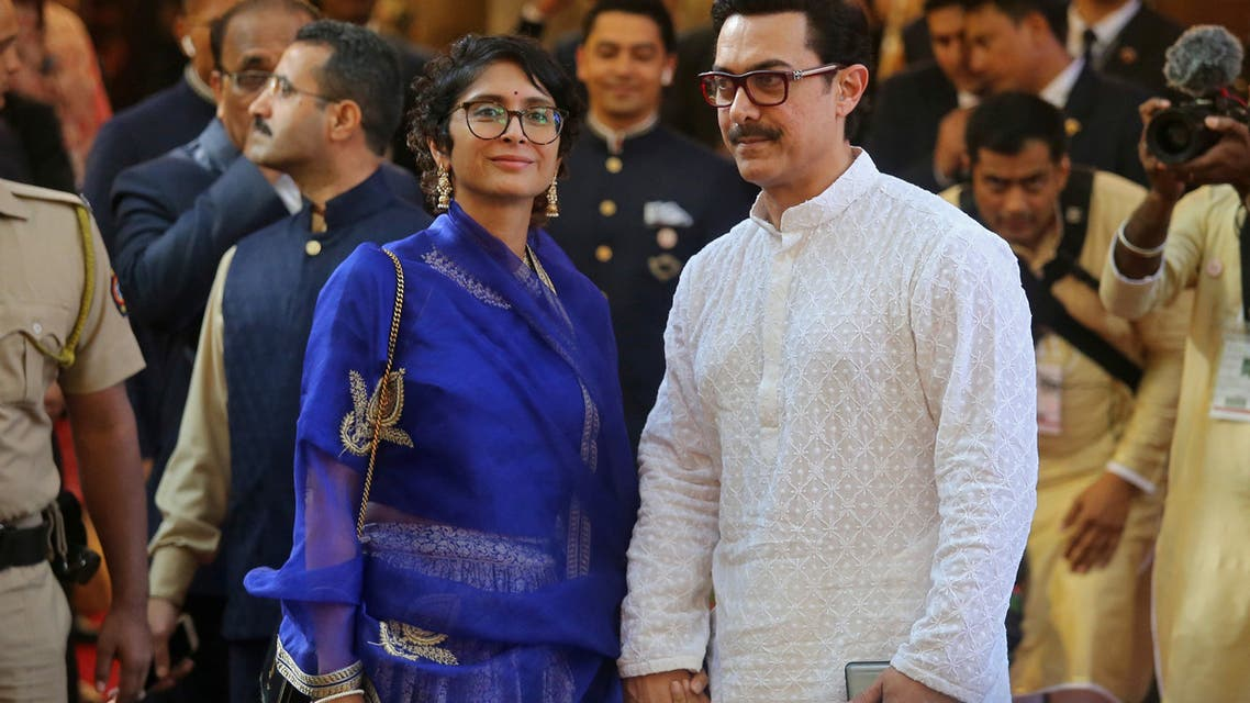 Bollywood actor Aamir Khan and his wife Kiran Rao arrive to attend the wedding of Isha Ambani, daughter of the Chairman of Reliance Industries Mukesh Ambani, in Mumbai, India, December 12, 2018. (Reuters)