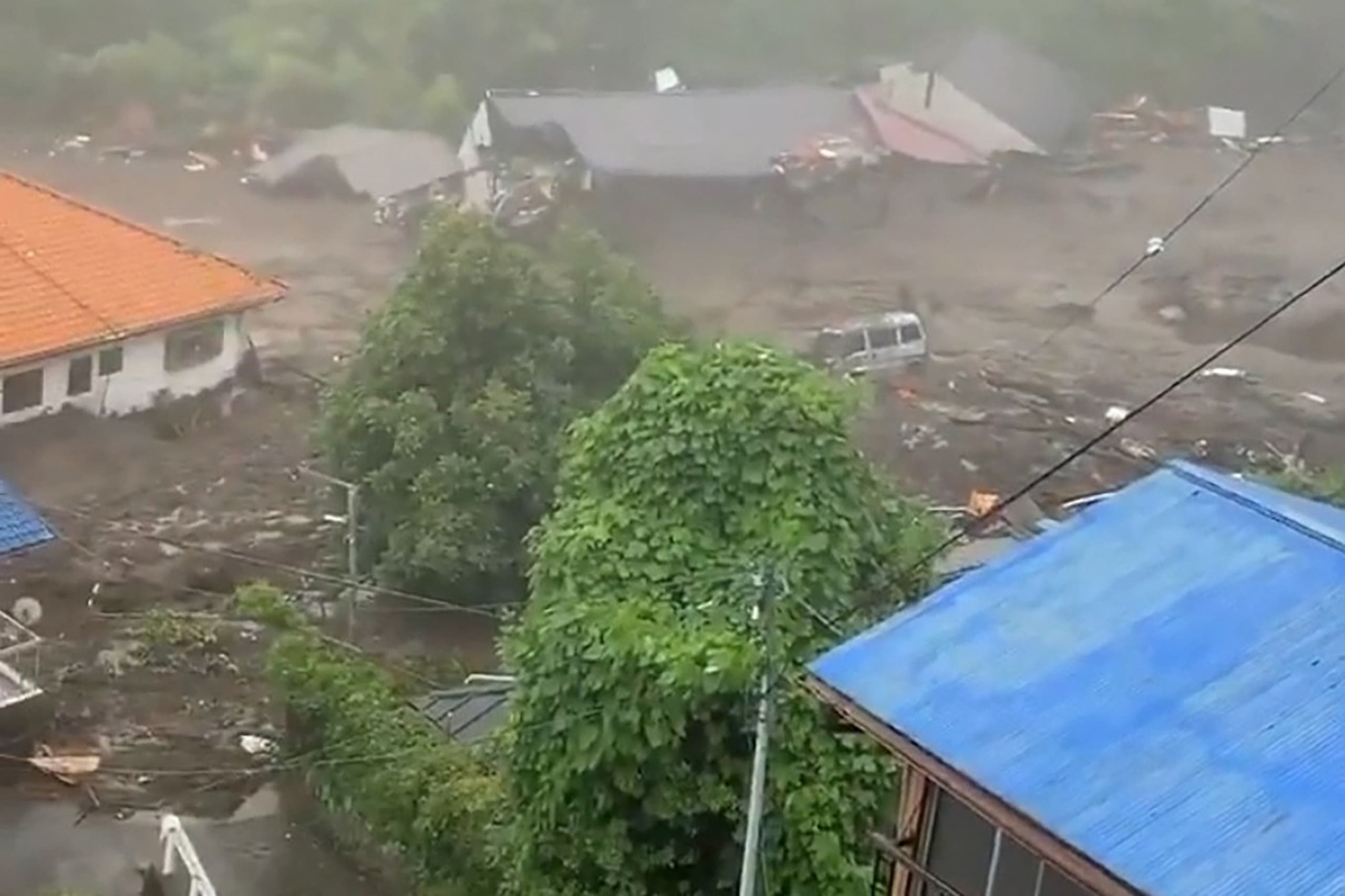 This grab taken from handout video released by a local resident and received via Jiji Press on July 3, 2021 shows mud and debris at the scene of a landslide that has left at least 19 people missing in the Izusan area of Atami in Shizuoka Prefecture. (AFP)