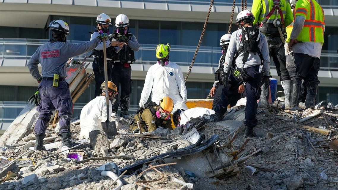 Search and rescue personnel work at the site of a collapsed Florida condominium complex in Surfside, Miami, U.S., in this handout image July 2, 2021. (MIAMI DADE FIRE DEPARTMENT/Handout via Reuters)
