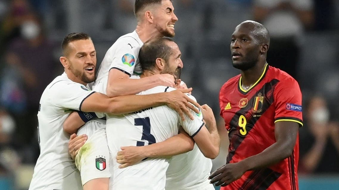 Belgium's Romelu Lukaku looks dejected as Italy players celebrate. (Reuters)