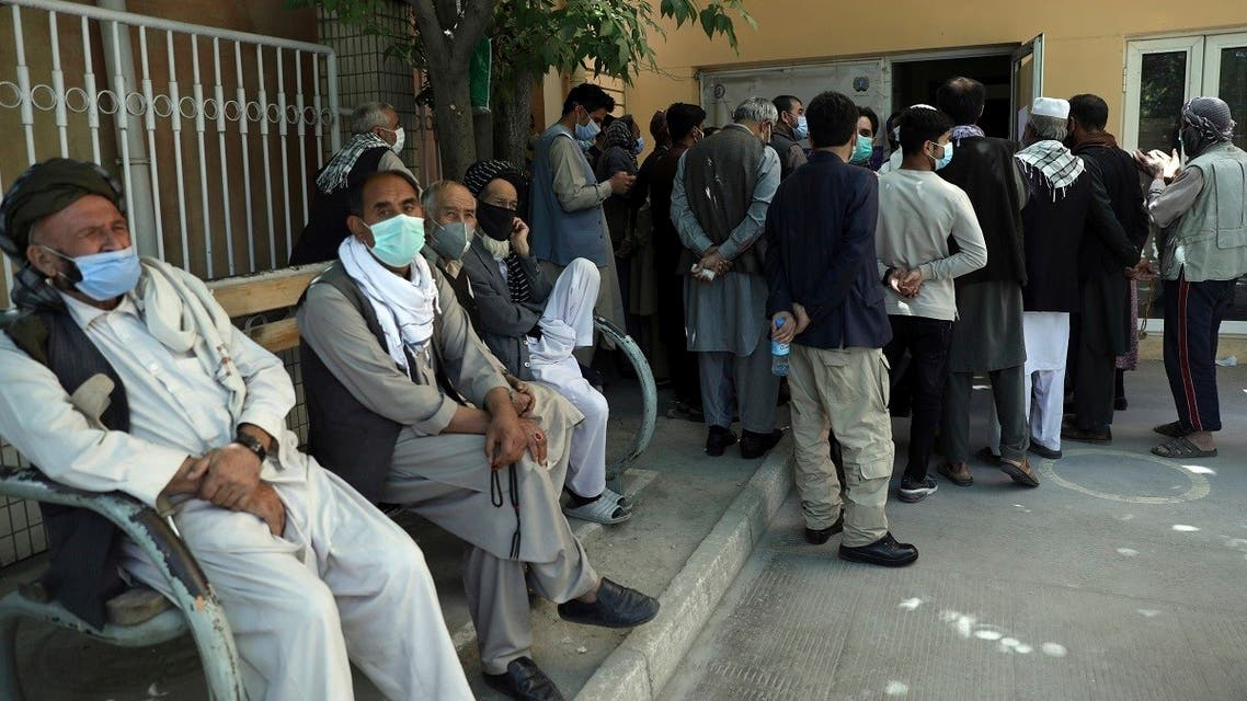 Residents wearing face masks to help curb the spread of the coronavirus line up to receive the Sinopharm COVID-19 vaccine at a vaccination center in Kabul, Afghanistan, June 16, 2021. (AP/Rahmat Gul)