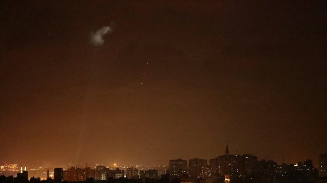 Shootings from the Palestinian territory light-up the night sky in Gaza city, on July 3, 2021, in response to the bombing of Israeli planes on Gaza military targets. (AFP)