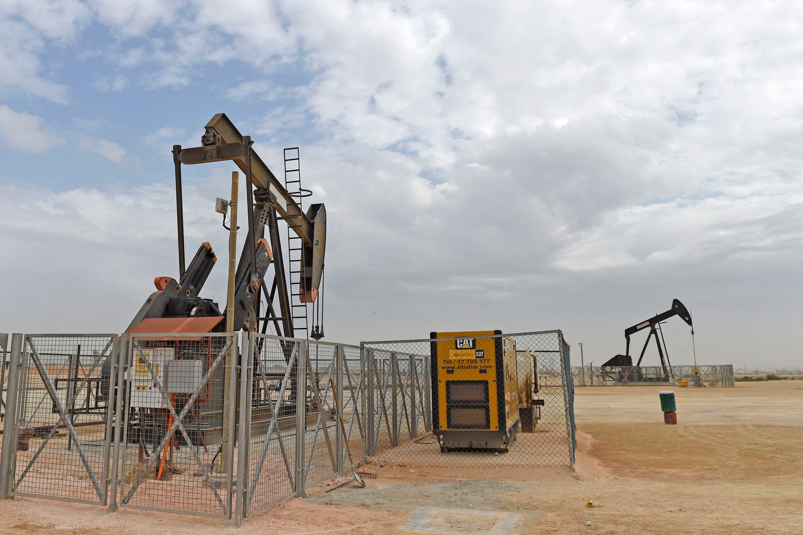 Pumpjacks operate in the desert oil fields of Sakhir in southern Bahrain on April 22, 2020. (AFP)