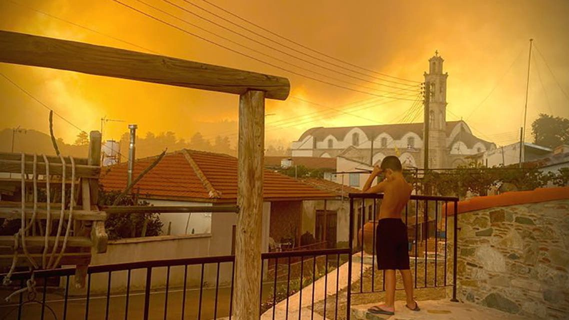 Smoke from a forest fire is seen in Ora village, Larnaca, Cyprus, July 3, 2021, in this picture obtained from social media. (Andrea Anastasiou via Reuters)