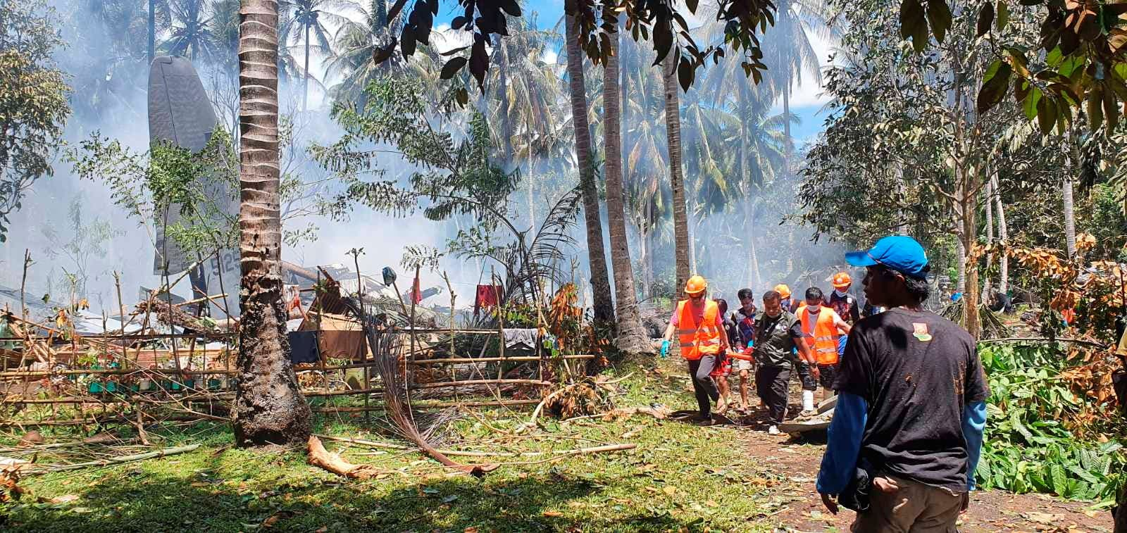 First responders work at the site after a Philippines Air Force Lockheed C-130 plane carrying troops crashed on landing in Patikul, Sulu province, Philippines July 4, 2021.  (Reuters)