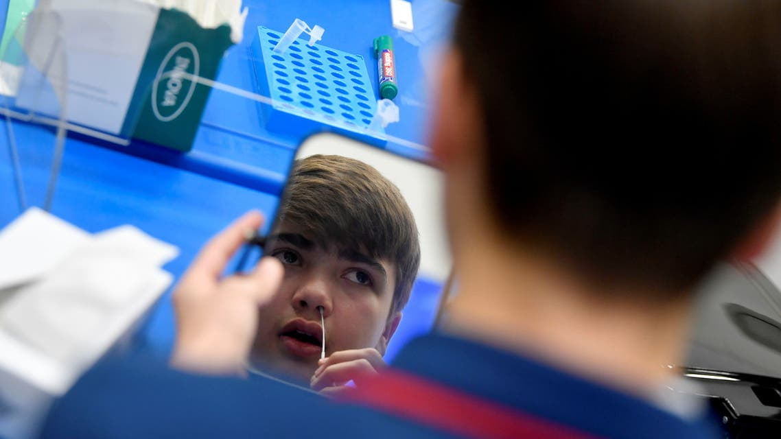 Year 10 student, Isaac O'Hare, 15, takes a coronavirus disease (COVID-19) test at Harris Academy Beckenham , ahead of full school reopening in England as part of lockdown restrictions being eased, in Beckenham, south east London, Britain, March 5, 2021. (Reuters)