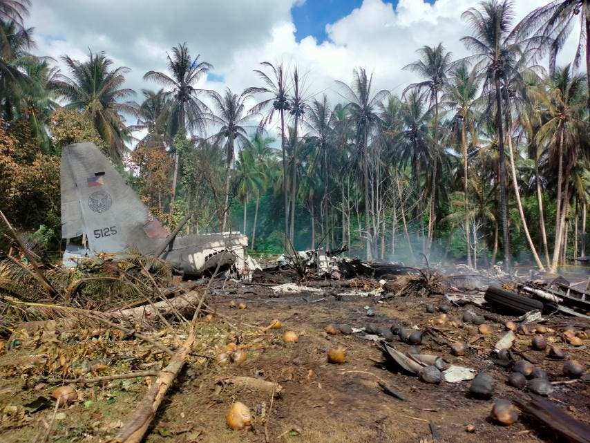 View of the site after a Philippines Air Force Lockheed C-130 plane carrying troops crashed on landing in Patikul, Sulu province, Philippines July 4, 2021. (Reuters)