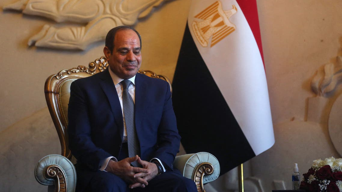 Egyptian President Abdel Fattah al-Sisi looks on as he is welcomed by his Iraqi counterpart (unseen) at Baghdad Airport in Iraq's capital on June 27, 2021.