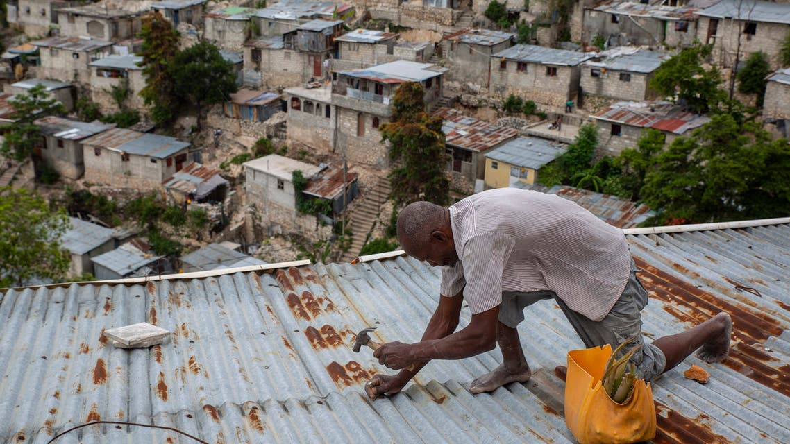Antony Exilien secures the roof of his house in response to Tropical Storm Elsa, in Port-au-Prince, Haiti, Saturday, July 3, 2021. (AP)