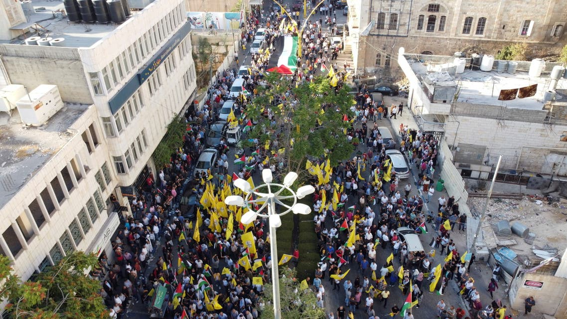 Palestinian demonstrators attend a protest in support of Palestinian President Mahmoud Abbas, in Hebron in the Israeli-occupied West Bank July 3, 2021. Picture taken with a drone. (Reuters)