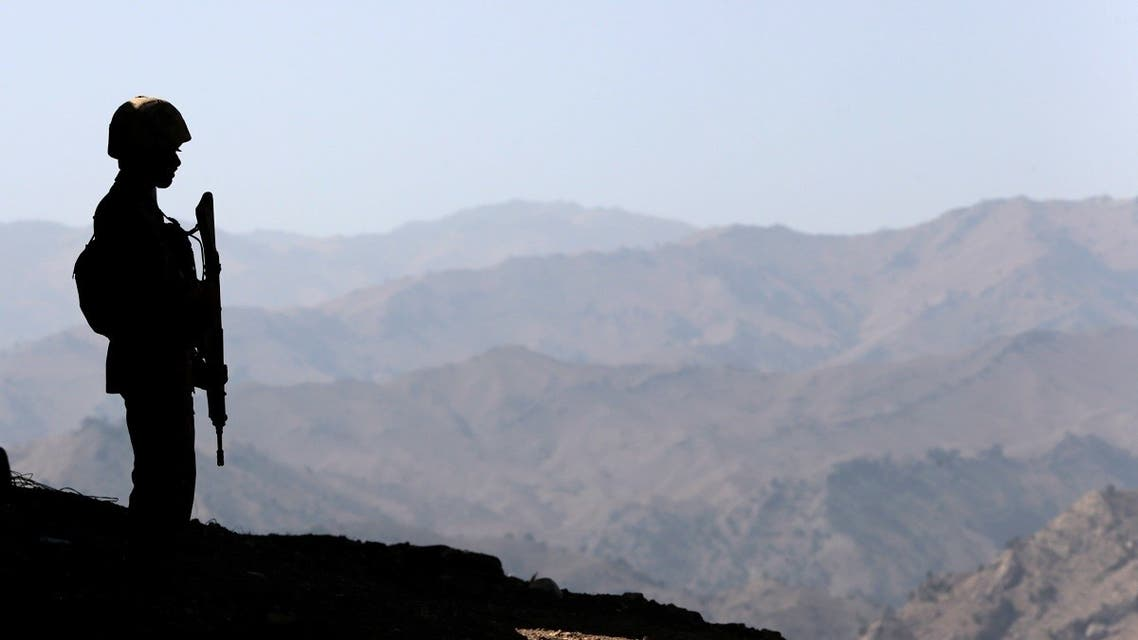 A soldier stands guard along the border fence outside the Kitton outpost on the border with Afghanistan in North Waziristan, Pakistan. (File photo: Reuters)