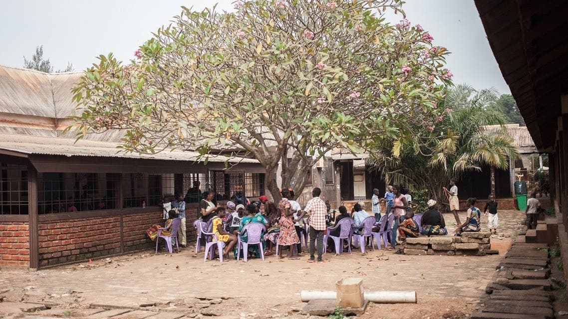 A group of HIV-positive children wait under a tree to receive their antiretroviral drugs at the Bangui pediatric complex, Central African Republic, December 4, 2018. (Florent Vergnes/AFP)
