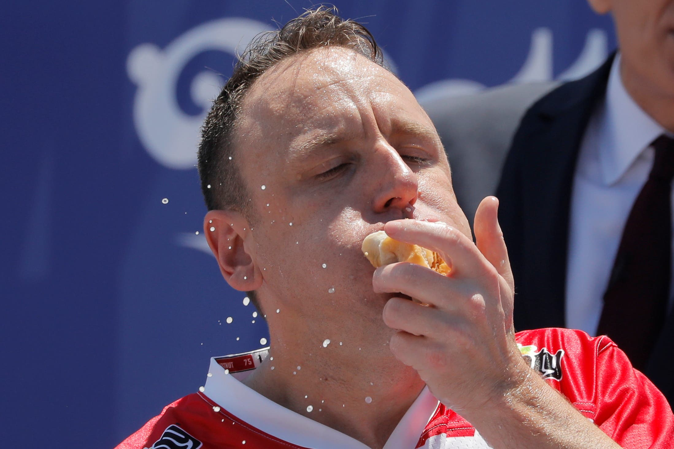Joey Chestnut competes during Nathan's Famous Fourth of July Hot Dog-Eating Contest held at Maimonides Park in New York City, New York, US, July 4, 2021. (Reuters)