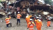 Rescuers in Japan search for 80 missing two days after deadly landslide