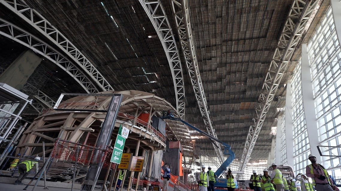 Visitors and journalists tour the construction site of the midfield terminal of Abu Dhabi International Airport in Abu Dhabi, UAE. (Reuters)