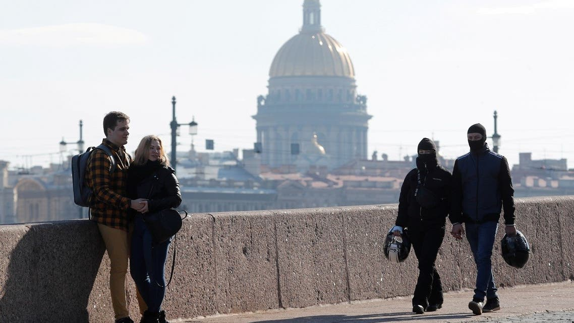 People rest on the Spit of Vasilievsky Island with the St. Isaac's Cathedral in the background in central Saint Petersburg, Russia. (File Photo: Reuters)