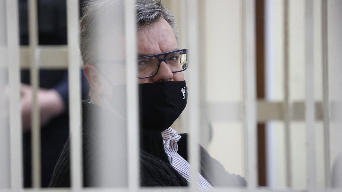 In this file photo taken on February 17, 2021 opposition politician and banker Viktor Babaryko, charged with corruption and money laundering, is seen from inside a defendants' cage during the opening day of his trial in Minsk. (File photo: AFP)