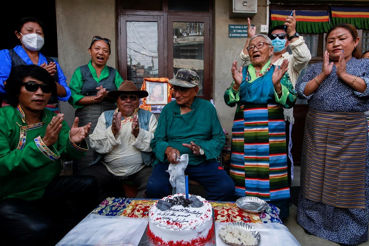 Tibetans dressed in traditional attire sing the birthday song before cutting a cake during a function organized to mark the 86th birthday celebration of Dalai Lama in Lalitpur, Nepal, on July 6, 2021. (Reuters)