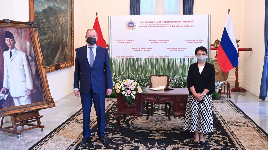 Russia's Foreign Minister Sergei Lavrov and Indonesia's Foreign Minister Retno Marsudi poses for pictures during a meeting in Jakarta, Indonesia, July 6, 2021. (Reuters)
