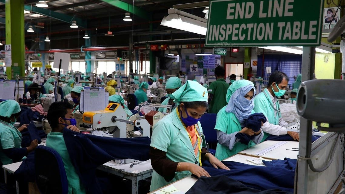 Garment employees work at Fakhruddin Textile Mills Limited in Gazipur, Bangladesh, on February 7, 2021. (Reuters)