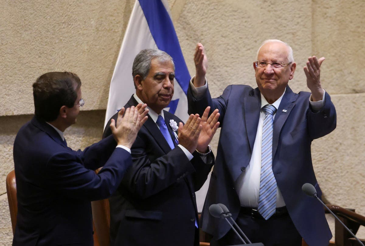 Outgoing Israeli President Reuven Rivlin gestures as Israeli President-elect Isaac Herzog and Chairman of the Knesset Mickey Levy applaud during a swearing-in ceremony at the Knesset, Israeli parliament, in Jerusalem on July 7, 2021. (Reuters)