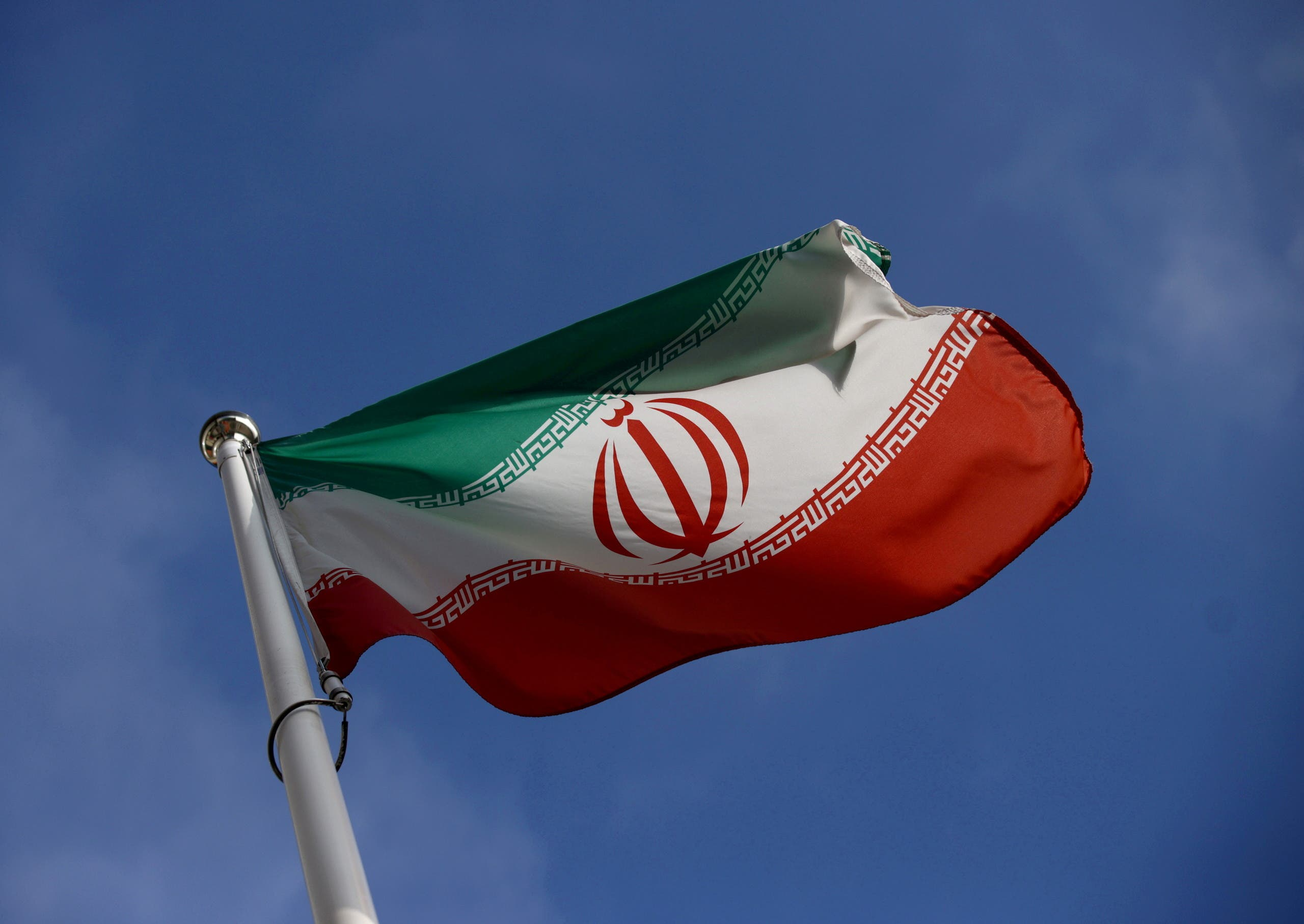 The Iranian flag waves in front of the International Atomic Energy Agency (IAEA) headquarters in Vienna. (File photo: Reuters)