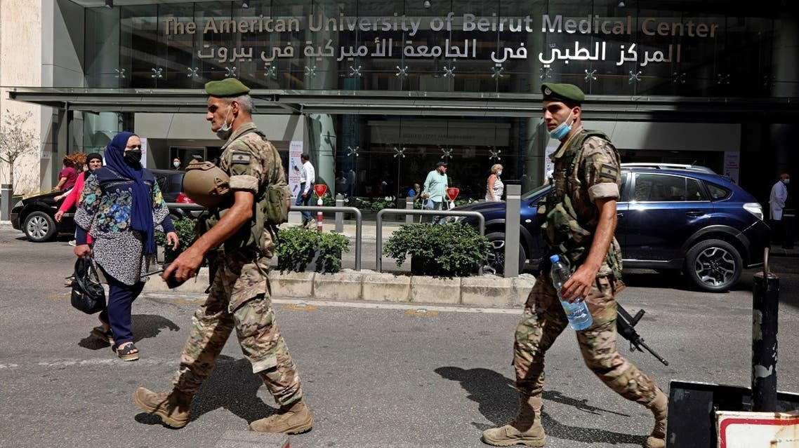 Two Lebanese soldiers walk as they secure the Medical Center at the American University of Beirut. (File photo:  Reuters)