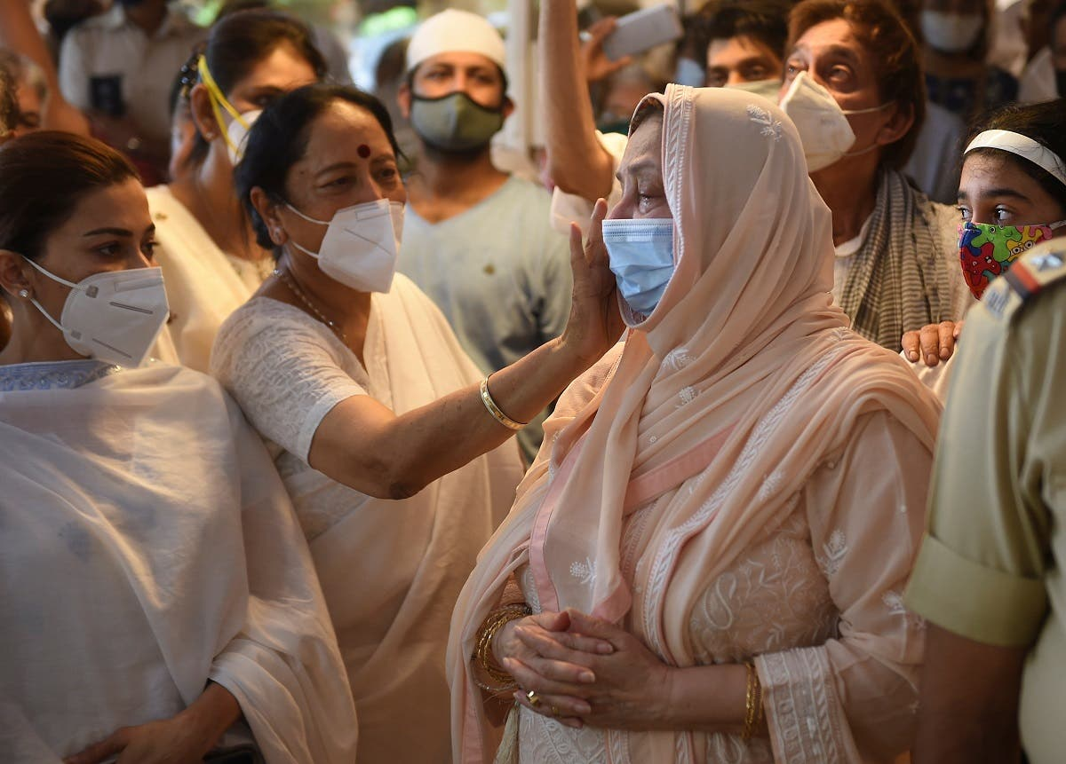 Saira Banu, wife of Bollywood actor Dilip Kumar, is consoled during the funeral of her husband in Mumbai, India, on July 7, 2021. (Reuters)