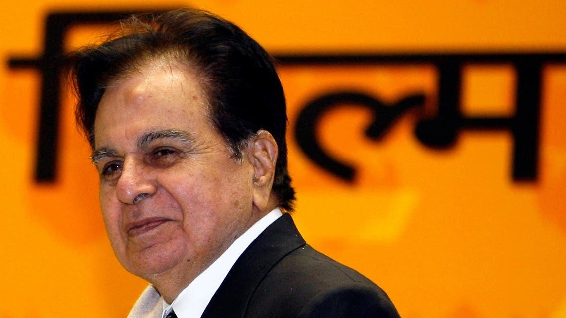 Bollywood star Dilip Kumar smiles after receiving a lifetime achievement award from India's President Pratibha Patil (unseen) during the 54th national film awards ceremony in New Delhi, on September 2, 2008. (Reuters)