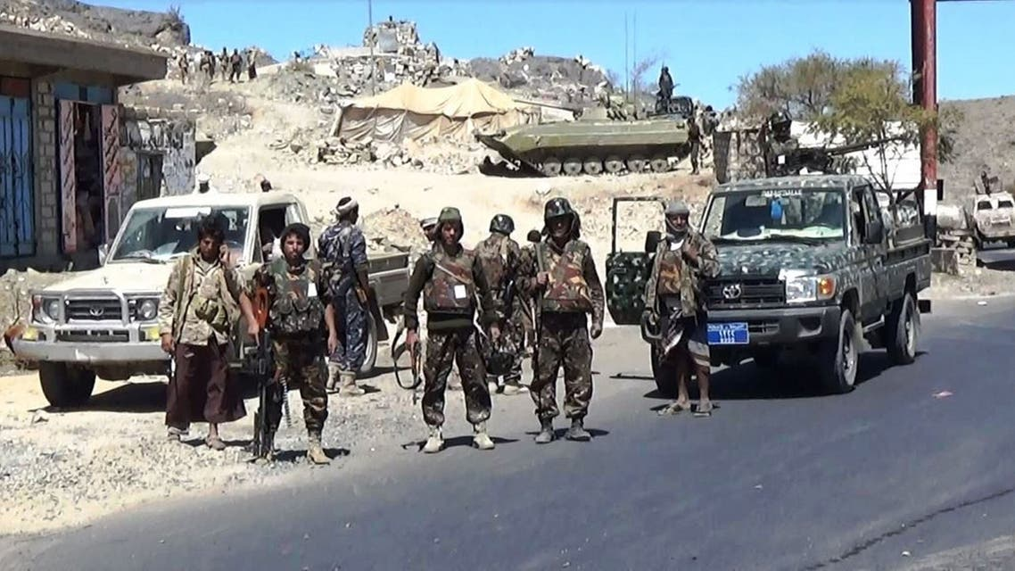 Shiite Huthi fighters loyal to the Republican Guard forces supporting former Yemeni president Ali Abdullah Saleh's stand near armed vehicles in the Al-Bayda province, south of Sanaa, on February 10, 2015 as they clash with armed militiamen. Yemen, which is riven by tribal divisions and awash with weapons, has been engulfed in crisis since veteran strongman Ali Abdullah Saleh was forced from power in 2012 following a bloody year-long uprising against his rule. AFP PHOTO / STR