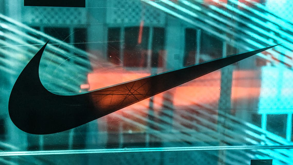 A Nike logo is seen at the Nike flagship store on 5th Ave. on December 20, 2019 in New York City. (AFP)