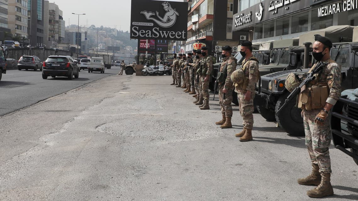 Lebanese army soldiers stand together as they are deployed in Zouk, Lebanon March 10, 2021. (Reuters)