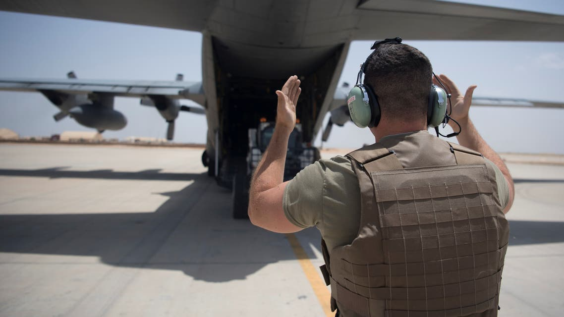 An Airman from the 746th Expeditionary Airlift Squadron guides a forklift off a C-130 Hercules at Udeid Air Base in Doha, Qatar, May 28, 2019. Picture taken May 28, 2019. Keifer Bowes/U.S. Navy/Handout via REUTERS ATTENTION EDITORS- THIS IMAGE HAS BEEN SUPPLIED BY A THIRD PARTY.